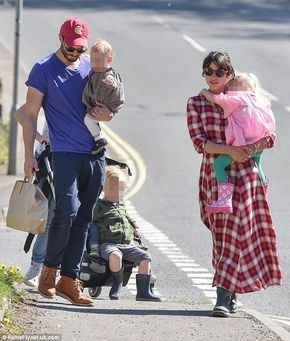 Happier than ever: Jamie Dornan and his wife Amelia Warner looked like the perfect family unit as they headed out for a stroll in the sun during an outing in their resident Gloucestershire over the weekend