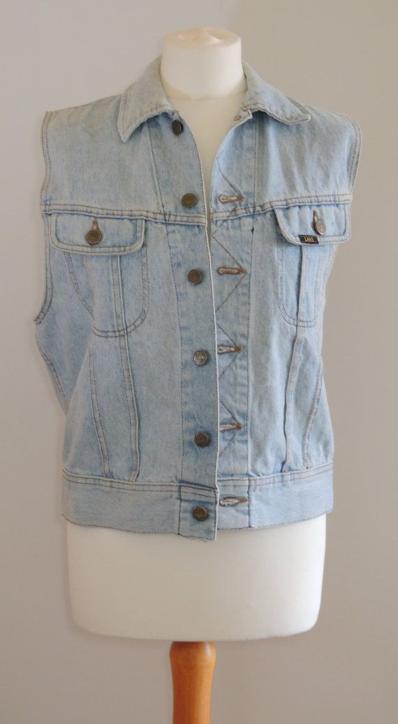 """★ Amazing 1980's/ 1990's stonewash denim waistcoat  ★ Button down front with zigzag embroidery  ★Panel detailing with two front pockets for your Iron Maiden tickets  ★ Can be comfortably worn over anything from a bikini to a tee to a checked shirt to your favourite jumper  ★ Label: Lee   Measurements (all taken while laying flat)  Bust - 16""""  Waist – 19.5""""  Length – 23.5""""  Shoulder Width – 14.5""""  Size: medium   In great condition with no noticeable defects."""