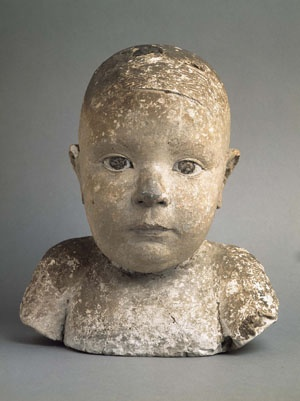 """Joan Rebull (Reus, Spain, 1899 - Barcelona 1981), Retrato de mi hijo Jordi (Portrait of my son Jordi), 1927. The most outstanding period in his sculpture lasted from 1927 to the beginning of the Spanish Civil War. This small head of polychrome raw clay, representing his first son, is characterised by absolutely original realism, rooted, as noted by the critic Sebastià Gasch, halfway between """"reason and instinct"""", between """"plastic and poetry."""" Collection Museo Reina Sofia, Madrid."""