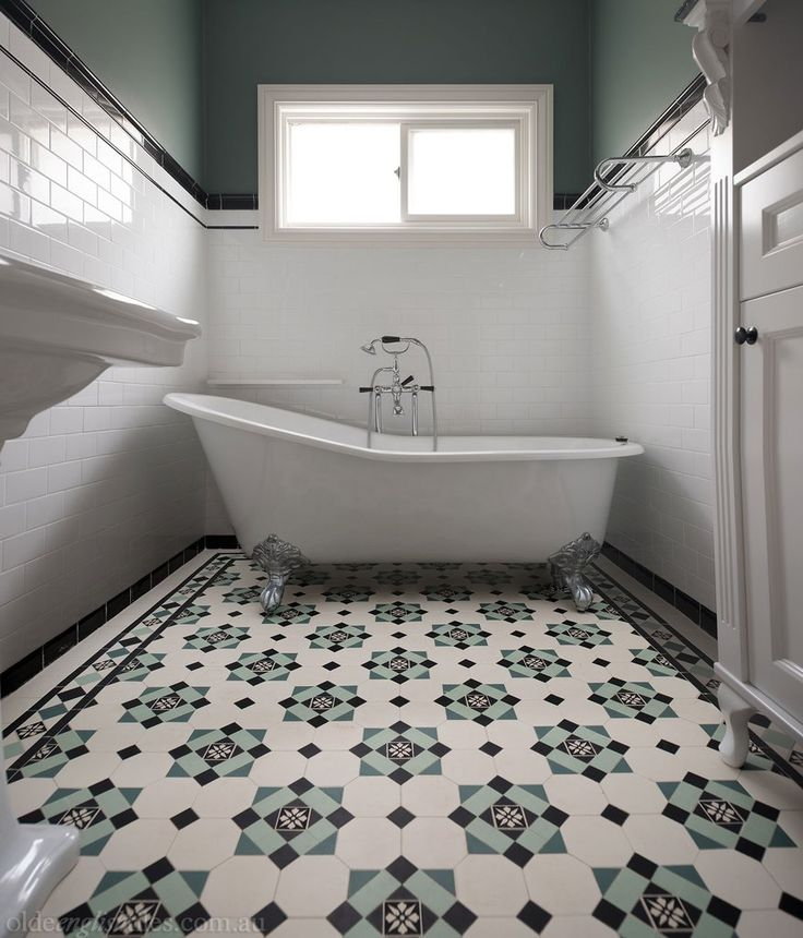 Bathroom Heritage Tessellated Tiles by Olde English Tiles.  Here we see theGlasgow pattern with the Norwood border    White wall tile
