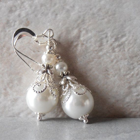 Hey, I found this really awesome Etsy listing at https://www.etsy.com/ca/listing/259635252/white-pearl-earrings-pearl-bridal