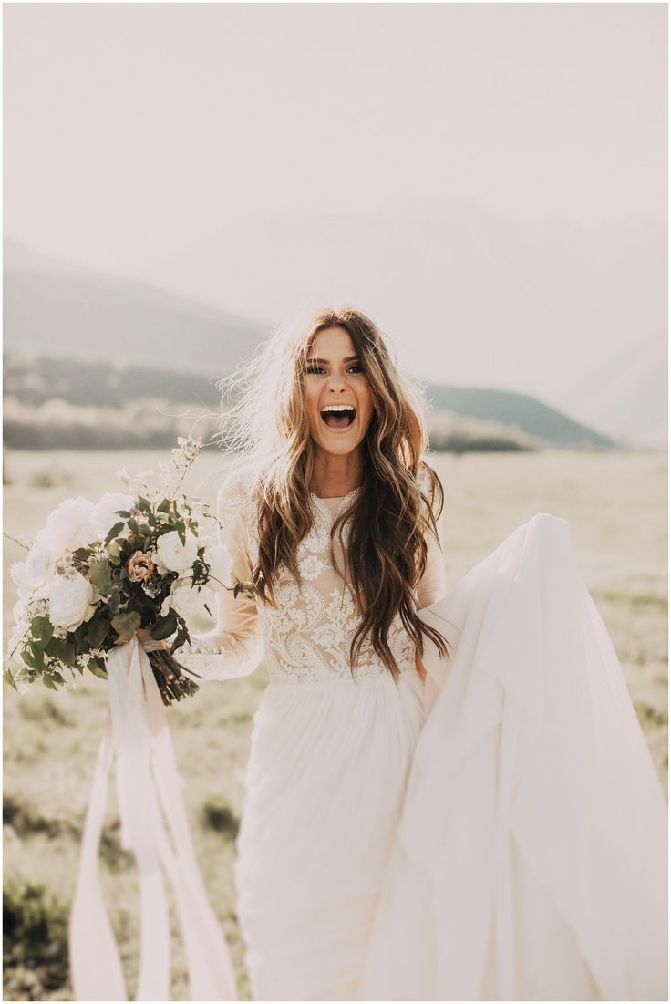 We love everything about this, the excitement, the bohemian vibe and the gorgeous lace wedding gown.