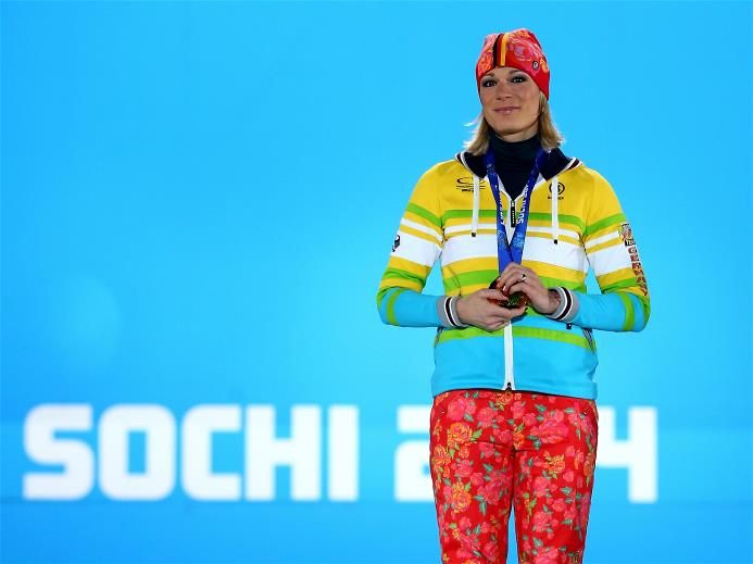 DAY 4:  Gold medalist Maria Hoefl-Riesch of Germany celebrates during the medal ceremony for the Alpine Skiing Women's Super Combined