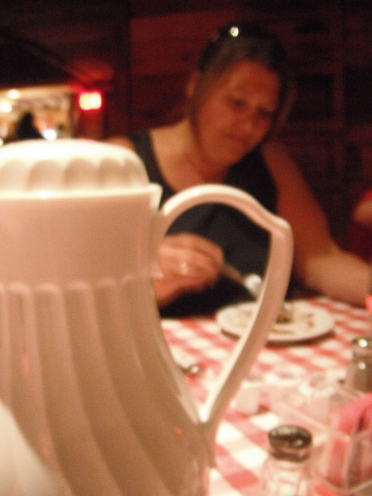 I really like that the focal point of this picture is the tea pot, with my mom sitting in the background.
