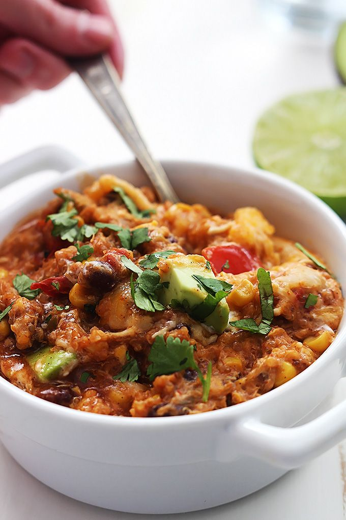 Healthy, easy enchilada quinoa made right in the crock pot. Just set it and forget it for a cheesy, protein-packed meal.