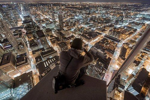 Incredible photo taken over downtown Toronto by @Roof Topper - do not try this at home, kids!!