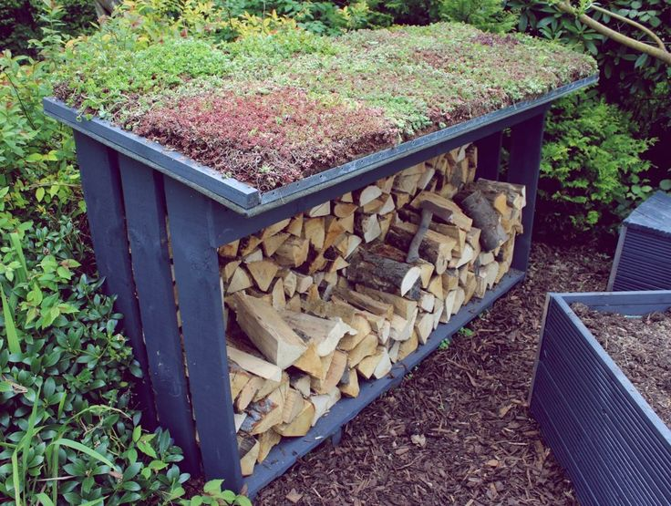 Log store with green roof