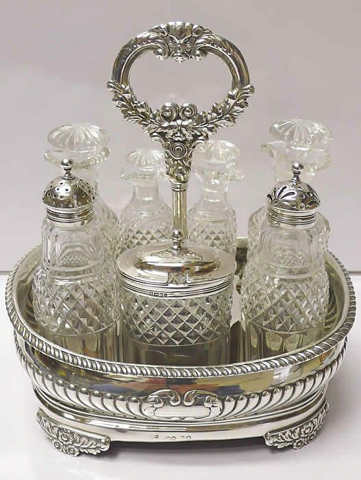 Georgian style antique sterling silver cruet with a set of 7 matching bottles.