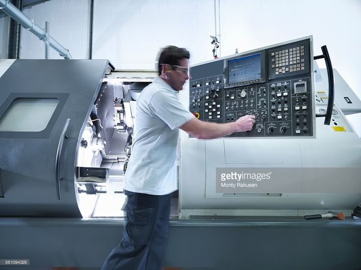 Stock-Foto : Engineer operating CNC lathe in factory