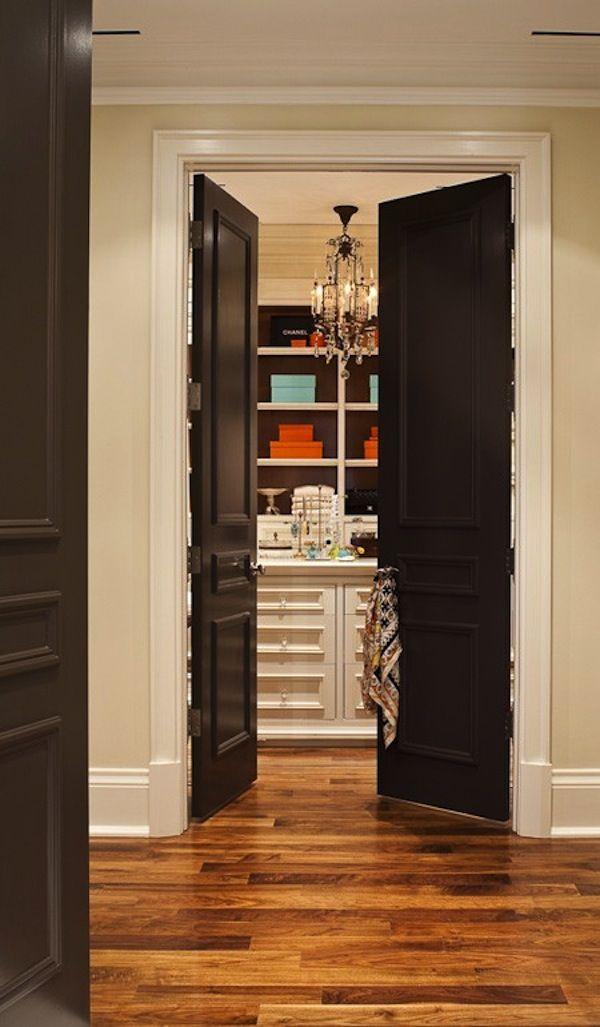 High gloss black doors on white trim.