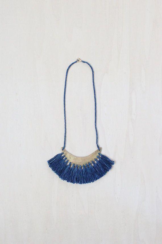 ESKER necklace | cast brass crescent with indigo dyed cotton tassel fringe and handspun cotton cord
