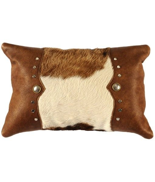 Gift Idea - Cowhide and Leather Pillow with Studs: Get the classic western look with this hair on hide pillow embellished with brown leather side panels, silver studs and ponchos. http://rusticartistry.com/product/cowhide-and-leather-pillow-with-studs/