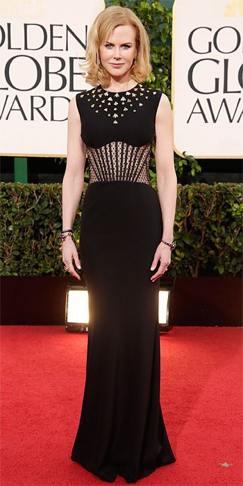 """Nicole Kidman at The Golden Globes 2013 in an Alexander McQueen black gown with studs and a sheer Deco waist because her husband, Keith Urban, told her, """"That's hot—wear that!"""" Easy choice! She completed her look with drop earrings and multiple bangles."""