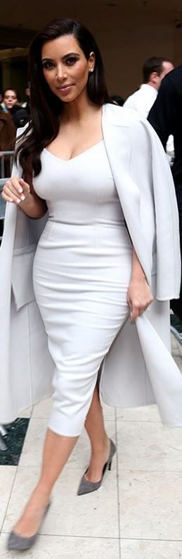 Kim Kardashian: Coat and dress – Max Mara  Shoes – Saint Laurent