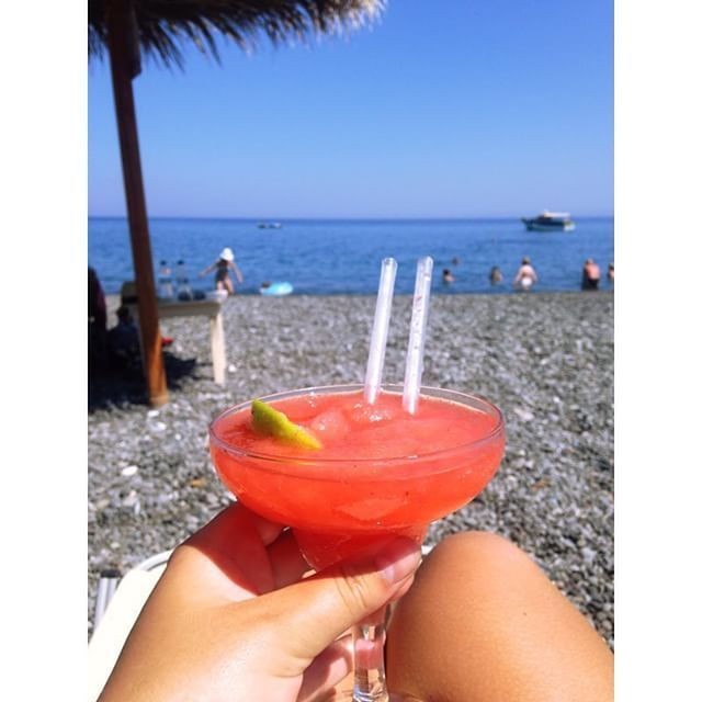 Enjoy a cocktail by the #beach of Kamari! #Santorini #Summer  Photo credits: @clarahandberg