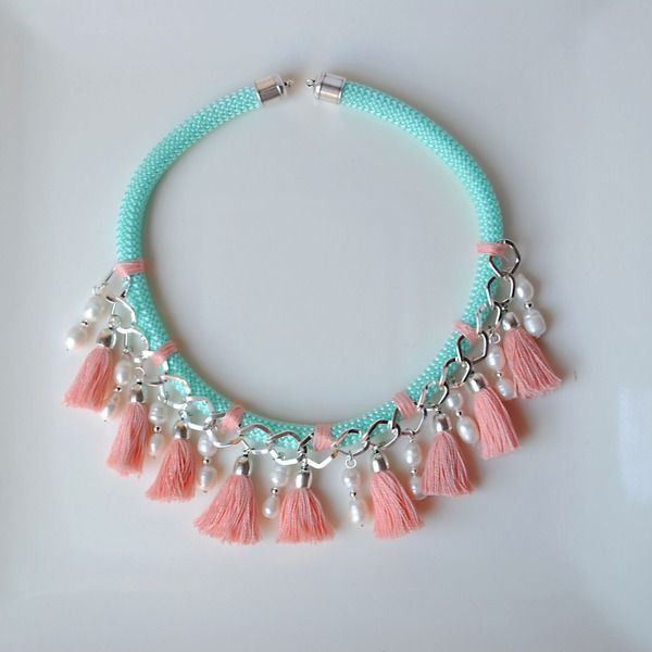 I love the pretty pink tassels on contrasting blue beadwork!