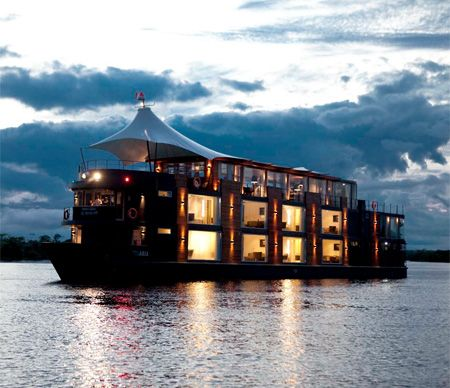 Luxury cruise ship with 16 modern hotel rooms allows people to safely and comfortably travel along the Amazon river in Peru.
