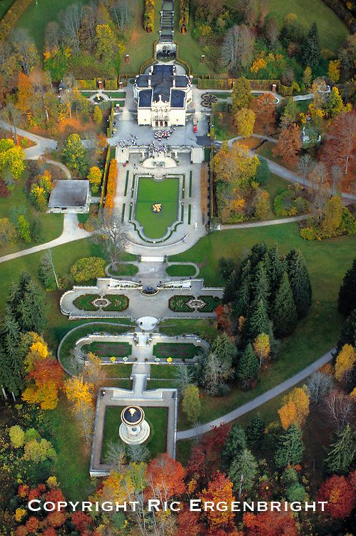 An aerial view of Linderhof Castle shows the intricate ...