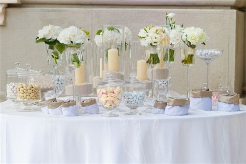 Beautiful cream and white candy buffet. Wedding candy