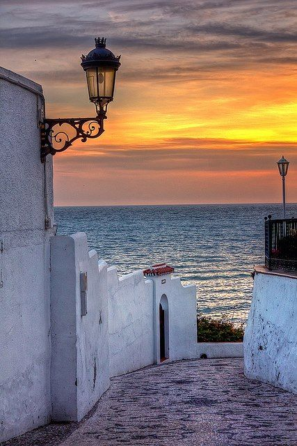 Mediterranean sunset in Nerja, Málaga, Andalusia, Spain. Where I spent many a happy summer. I know this street and I know the heaven it leads to.
