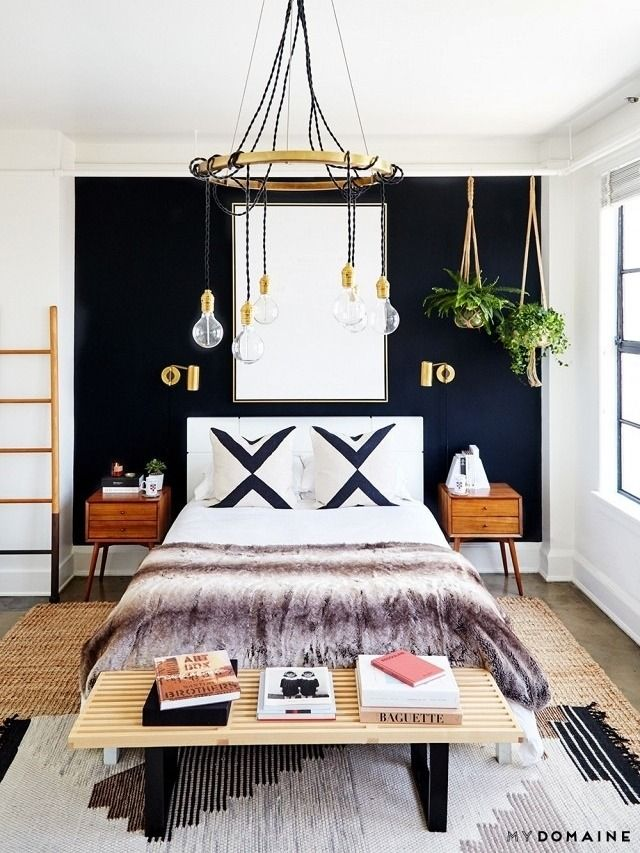 This bold bedroom is all about its high-contrast black and white palette, warmed up by wood, jute and brass. Be fearless with graphics—and wall paint—knowing that the natural elements will keep things from feeling too sterile. And a giant ombre faux fur blanket is the opposite of antiseptic!