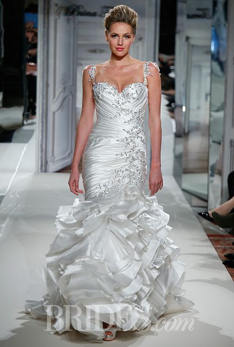 Brides.com: . Wedding Dresses for Plus-Size Body Types: Pnina Tornai for Kleinfeld. Asymmetrical pleating and neckline-to-knee embellishments make this curve-hugging gown more slimming.  Style 4278, silk taffeta dropped waist mermaid wedding dress with jeweled strap and tiered ruffle skirt, Pnina Tornai for Kleinfeld