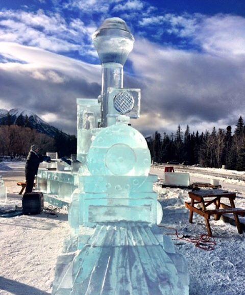 Banff snapshot, 1:23pm. Carvers build a massive ice locomotive at the Banff train station, part of our SnowDays Festival, kicking off Friday! #mybanff  #explorealberta