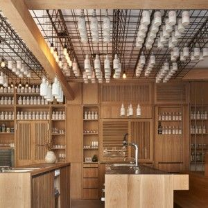 Buero Wagner suspends bottles of foraged  ingredients from ceiling of cocktail bar