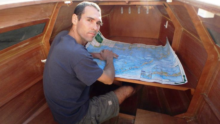 The cabin provides sitting headroom and a table for dining and navigation. The RoG's designer, JF Bedard, takes a look here at a chart of Florida Bay.