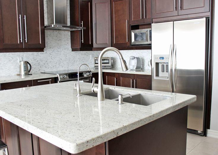 Moenu0027s Arbor One Handle Kitchen Faucet, Dark Maple Kitchen Cabinets,  Kashmir White Granite
