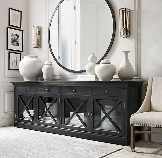 RH's French Neoclassical Glass Sideboard:Echoing the elegant form of its inspiration – a French neoclassic revival antique – our cabinet boasts molded cornices and glass doors with distinctive X-shaped muntins for a commanding presence.