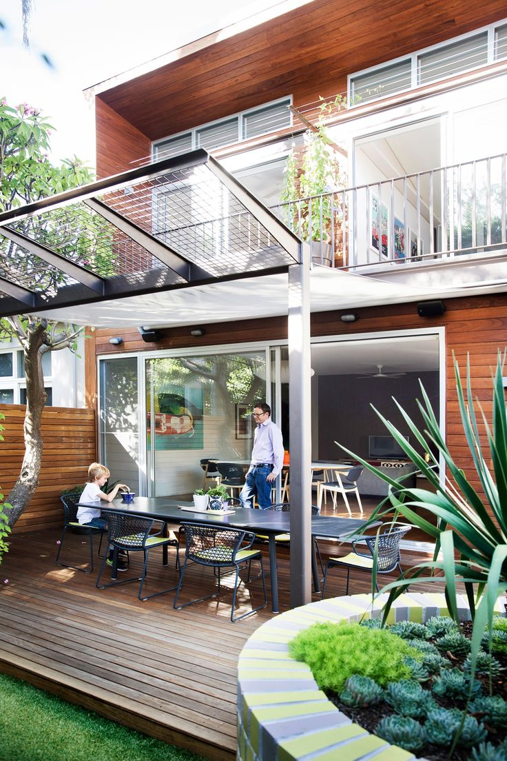 """A contemporary extension to a 1930s semi in Bondi saw the creation of this north-facing deck, which is shaded by a mature frangipani tree and has a wonderful sense of calm. [Take the home tour.](http://www.homestolove.com.au/gallery-julie-and-hamishs-renovated-sydney-semi-2290