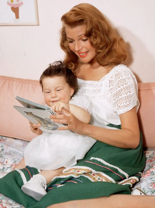 Rita Hayworth with her daughter Rebecca wearing Mexican influenced blouse and skirt, 1940s