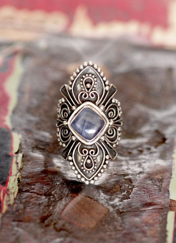 ❘❘❙❙❚❚ Vacation Sale ❚❚❙❙❘❘ Skystream a Kyanite statement ring with a whimsical feel. Blown away by the healing properties of the genuine Kyanite Gemstone I decided to give it a solid 925 sterling silver bohemian face to match. Unique in shape and a state
