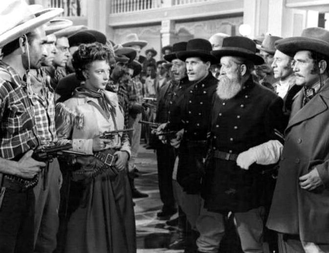 """In the centre of the picture: Isa Barzizza in Mario Mattoli's comedy """"Adamo ed Eva"""" (English title: """"Adam and Eve"""", 1949), also starring Macario (Erminio Macario)."""