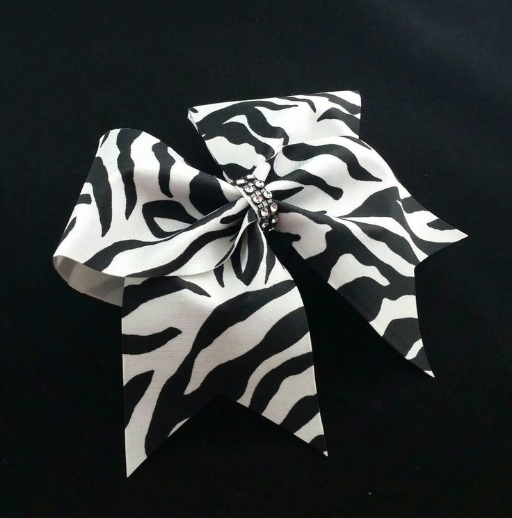 Cheer bow, Zebra print cheer bow, white cheer bow, black cheer bow, Cheerleading bow, Cheerleader bow, bow, softball bow, rec cheer bow, bow by MadeForMeCheerBows on Etsy https://www.etsy.com/listing/275611058/cheer-bow-zebra-print-cheer-bow-white
