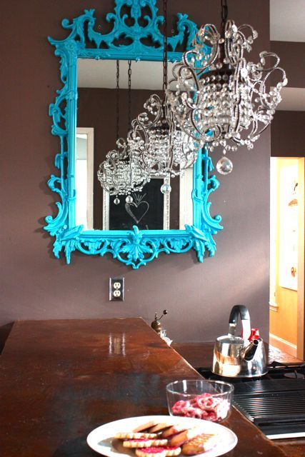I'm just going to have to find an ornate mirror like this and paint it an absurd color. dreamy.