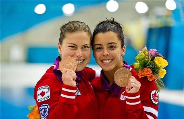 Canada's Roseline Filion and Meaghan Benefeito celebrate bronze medal finish in the women's synchronised 10-meter platform finals at the 2012 Summer Olympics in London on Tuesday, July 31, 2012.