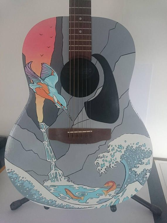 Ovation style Applause acoustic guitar, stripped back and hand painted using specialist hard wearing sign writers paints with a one off original design of a kingfisher diving for brook trout with a Hokusai inspired wave in the foreground.