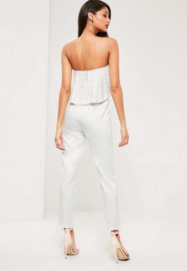 Elevate your evening game wearing this beaut white jumpsuit - featuring a bandeau style top and lace details.
