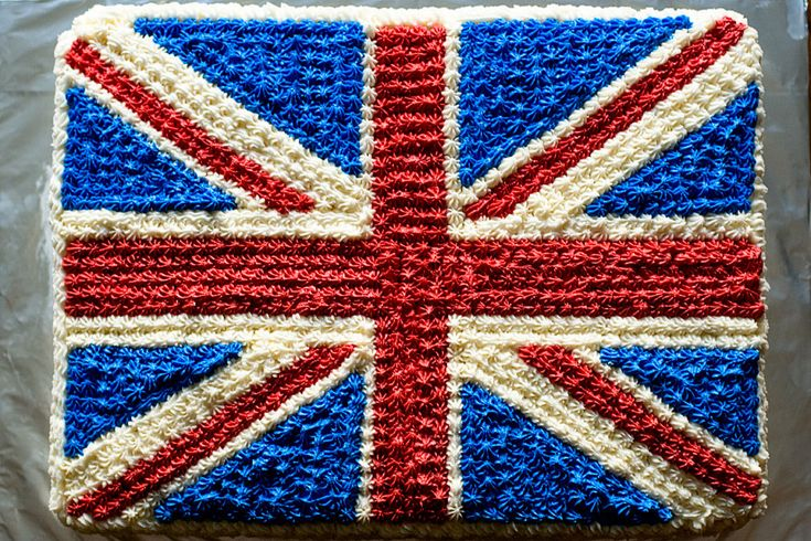 "As promised yesterday, here is the Union Jack cake! This cake was much easier to make than it maybe looks -- but it was VERY time-consuming (each of those little blobs of frosting was piped on -- it took a while!).	This cake was 11""x15"" in size. I made chocolate cake from a box mix and the cake…"