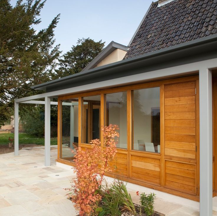 Modern extension to listed farmhouse, Norfolk  Oak boarding and joinery, steel frame