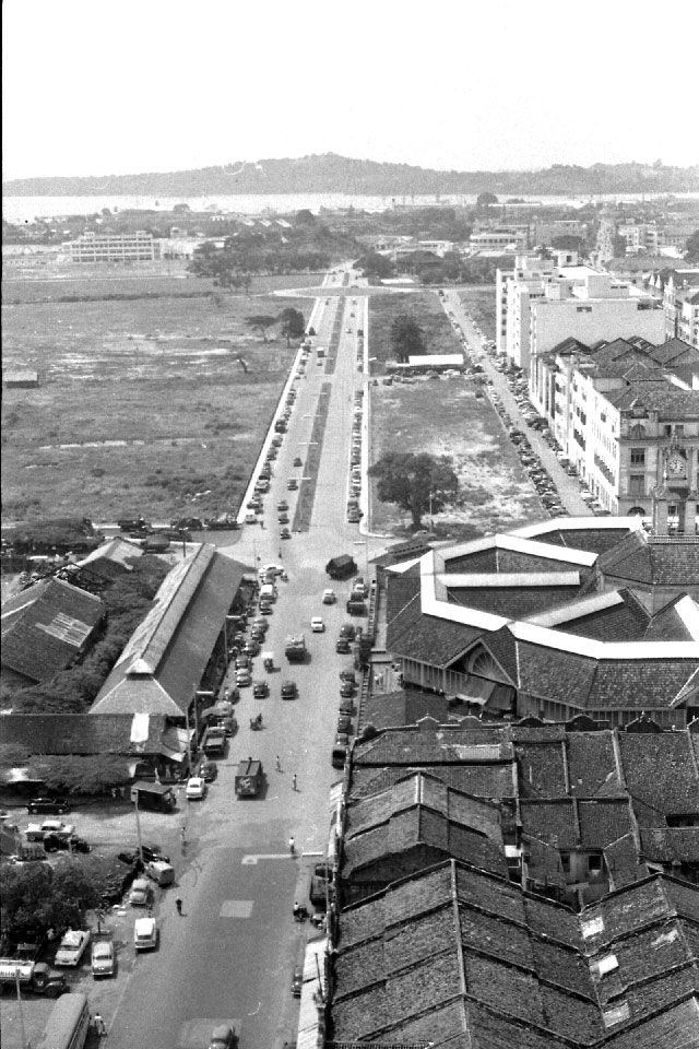 In the distance Keppel Harbour, Empire Docks and Raffles Quay, taken from the top of the Asia Insurance Building. At the time in 1956 it was the tallest building in Singapore. Just out of the picture to left is the Telok Ayer Basin. Photo by Ray Gipson (1956)