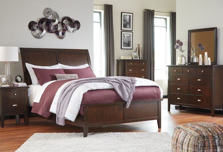 Evanburg 4pc Sleigh Bedroom Set in Brown Made with Okoume veneer and hardwood solids finished in a transitional Cherry color. Low profile sleigh bed is available with two drawer storage footboard or non-storage panel footboard. Drawers have metal center guide and boxes are dovetailed with paper wrapped finish. Decorative hardware consists of a combination of round metal knobs and trendy bin pulls. Cases feature a stylish off-the-floor look. Set Includes: 1 Sleigh Bed, 1 Nightstand, 1…