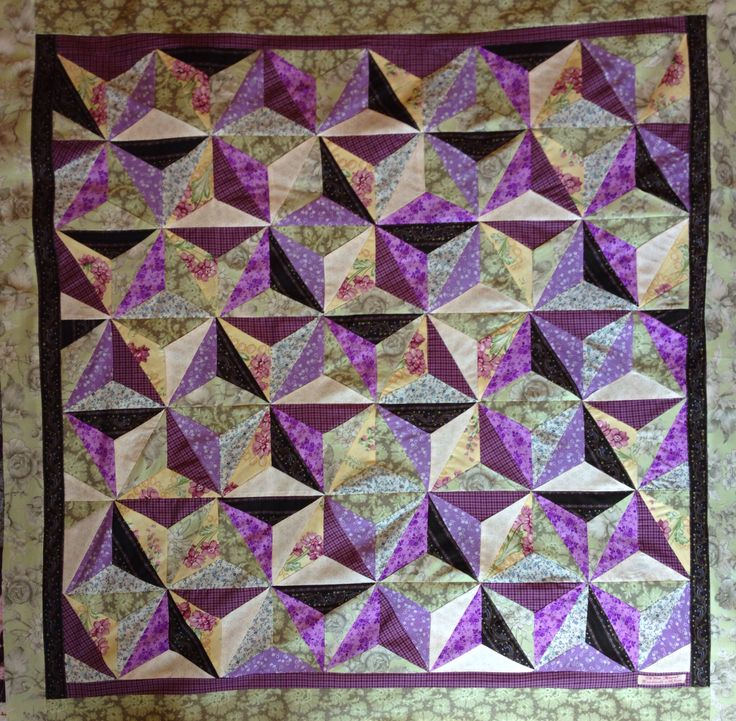 Handmade quilt by Oh Sew Maeve  Lovely vintage hues of purple and green