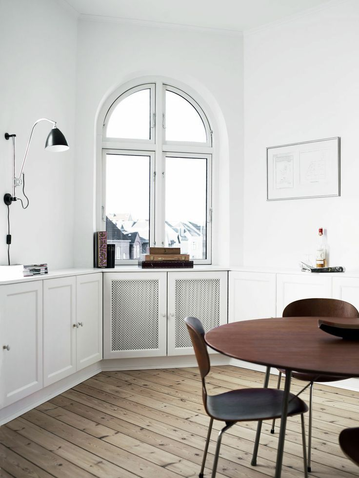 raw wood floors, corner windows with a gorgeous view, radiator cabinet covers, black and walnut :: living & dining rooms