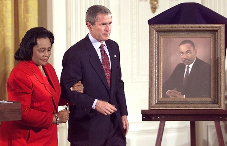 Coretta Scott King: U.S. President George W. Bush (R) escorts Coretta Scott King throughout the White House after the signing of a proclomation celebrating Martin Luther King, Jr. Day on January 21, 2002 in Washington D.C. (Photo by TIM SLOAN/AFP/Getty Images)