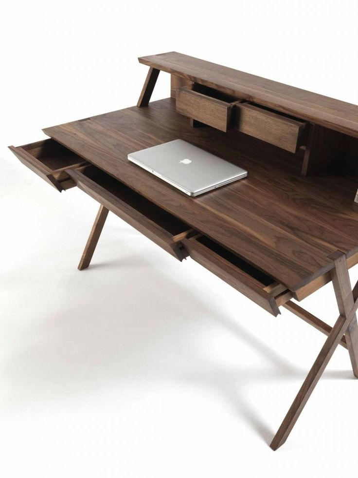 I like the simplicity of the desk design and the placement of all drawers. Perhaps it would be great to not have a desktop on this desk since it would take away from the desk's shape. (At least, that's what I would think.)    [Navarra (RIVA 1920)]