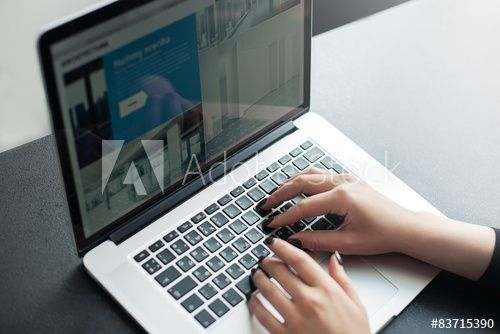 Shot of a young woman working with laptop, woman's hands using