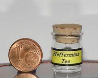Miniatur aus Glas,mundgeblasen,Maße:Höhe=22 +-1 mm,Ø=15 mm, Pfefferminz Tee
